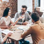 Business Team Discussing Employee Handbook Essentials