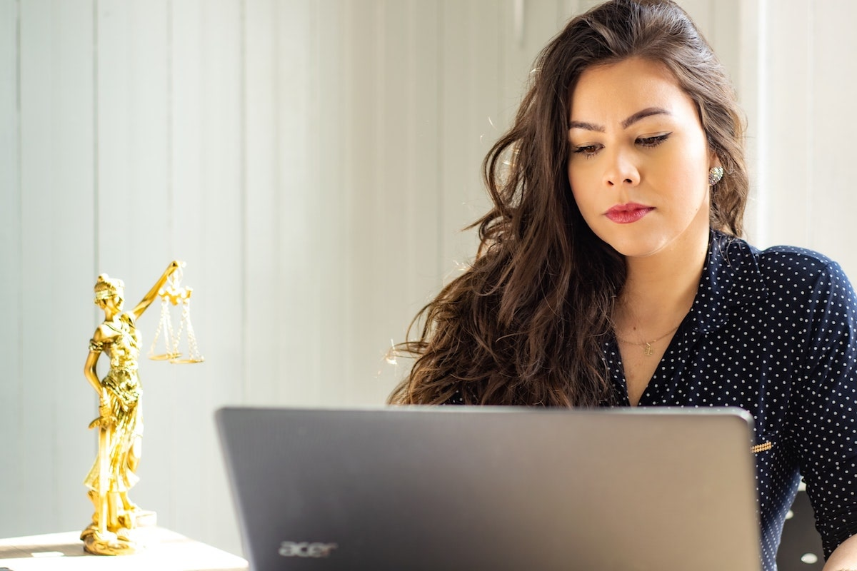 hr manager on laptop computer trying to reduce turnover rate