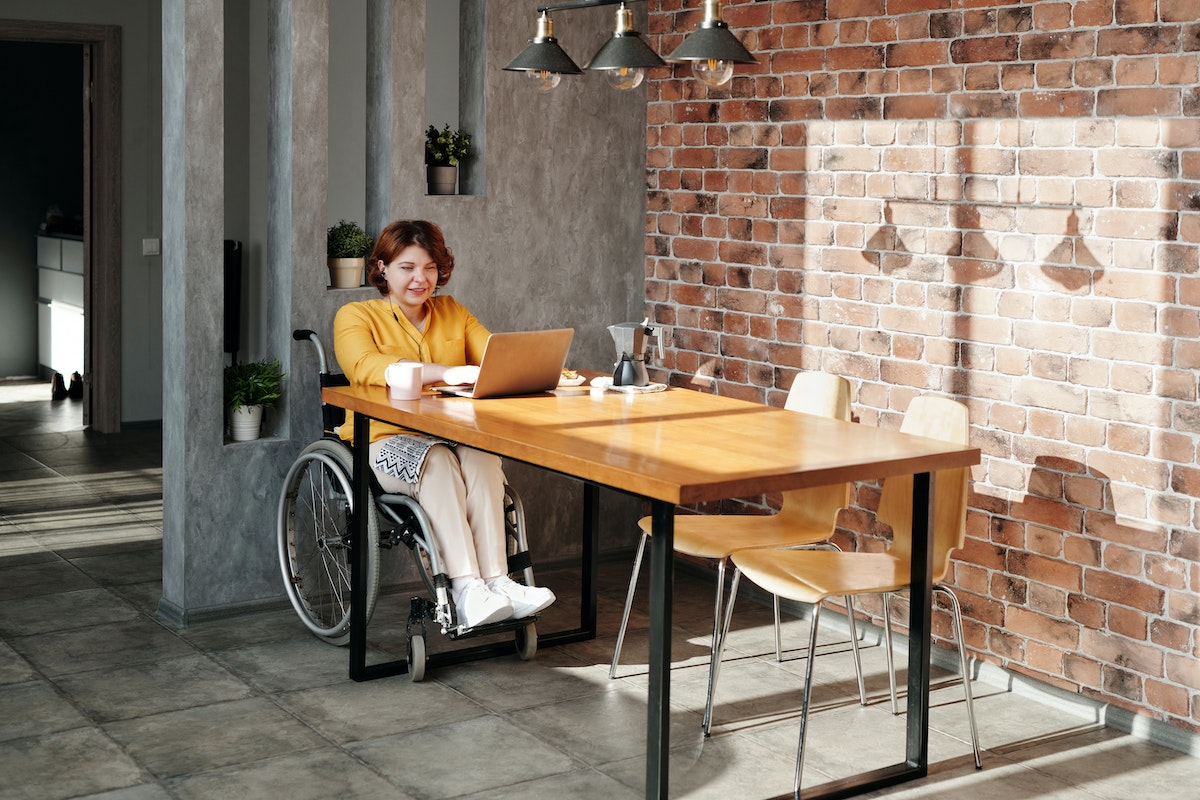 woman in wheelchair working from home
