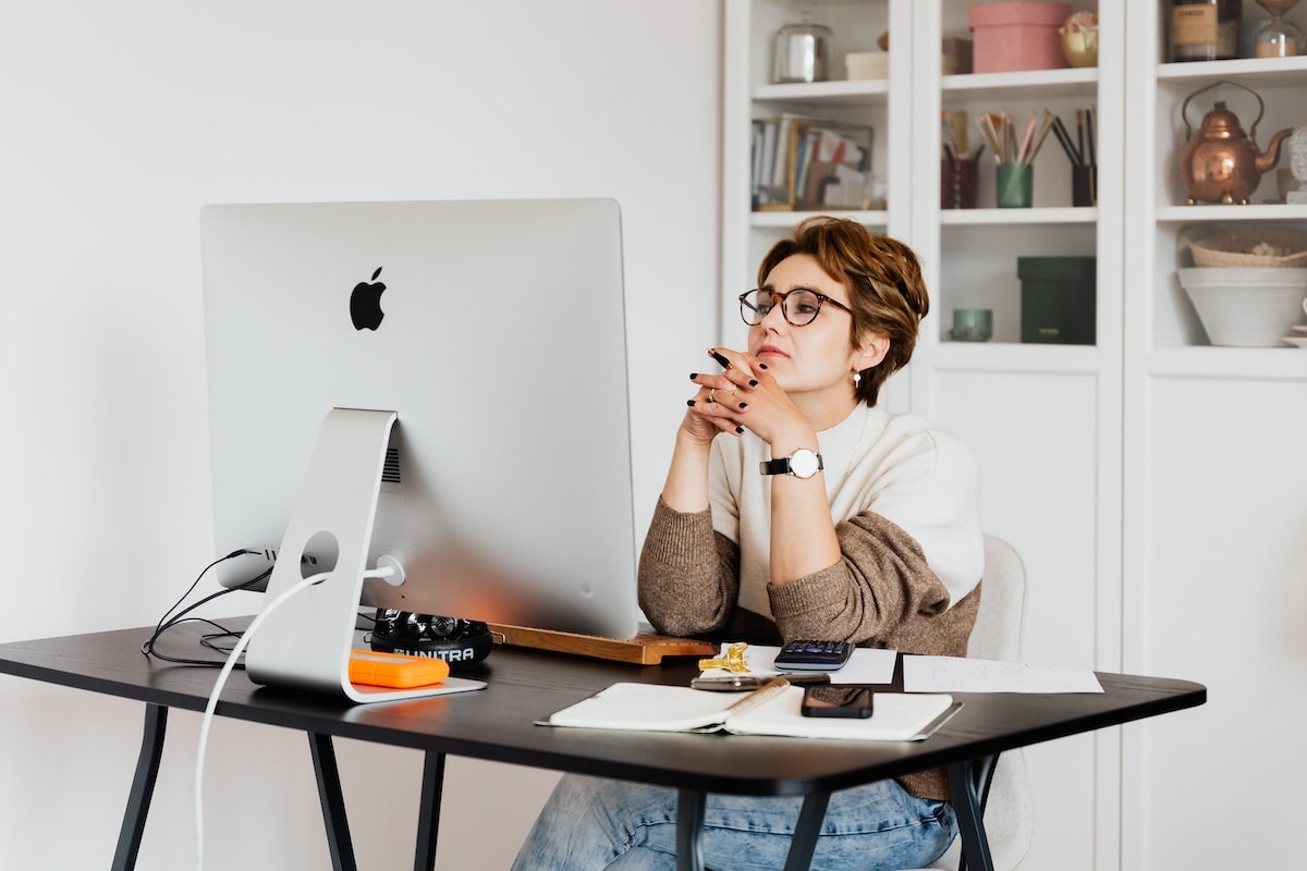 woman working from home at desk with computer
