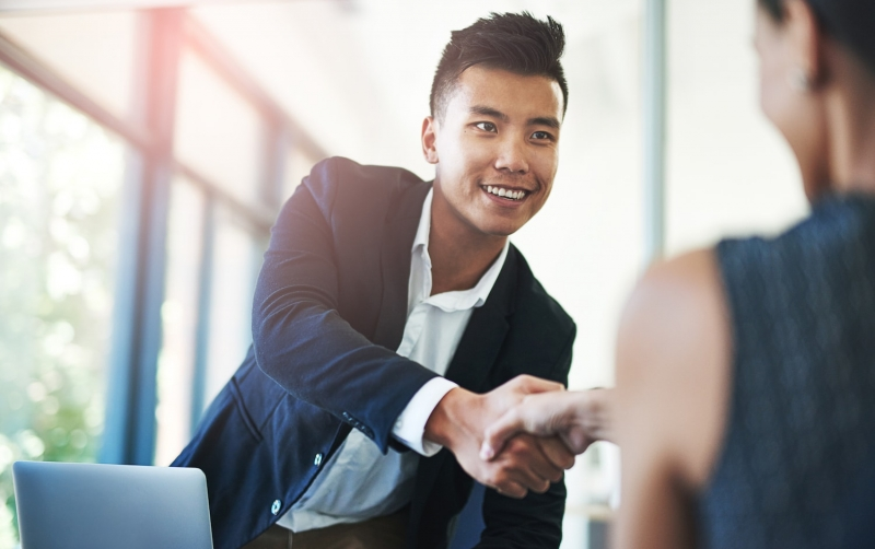 Job seeker shaking hands after successful interview